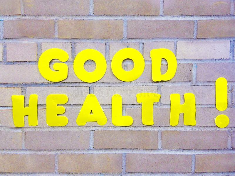 Good Health sign symbol title concept. Bright yellow Good Health sign symbol title concept on brick wall care healthcare royalty free stock photos