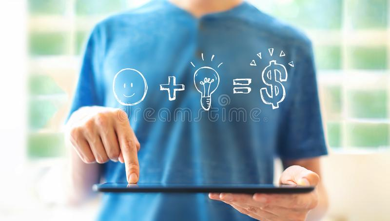 Good idea equals money with man using a tablet stock photography