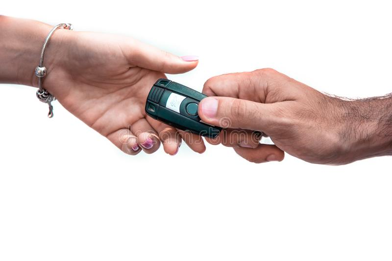 Human hand passing car keys to another hand on white isolate. Good idea, human hand passing car keys to another hand on white isolate stock photography