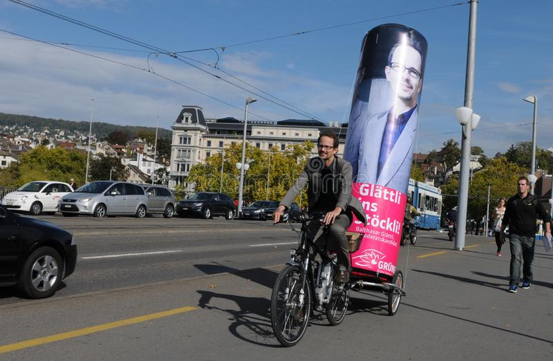 National Councillor Balthasar Glättli from the green party campaigning as a candidate with his bicycle on Quaibridge in Zürich. Good idea: National royalty free stock photo