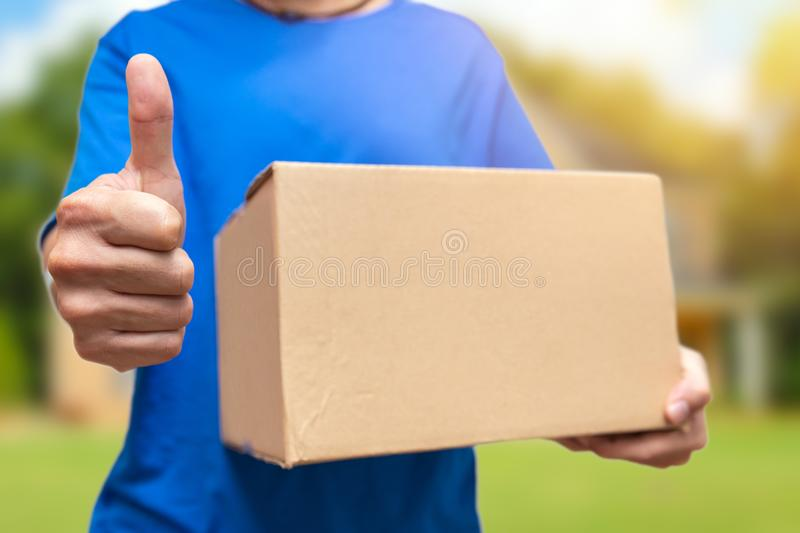 Good item or best shipping thumbs up. Good item or best shipping fast man holding big box and thumbs up stock images