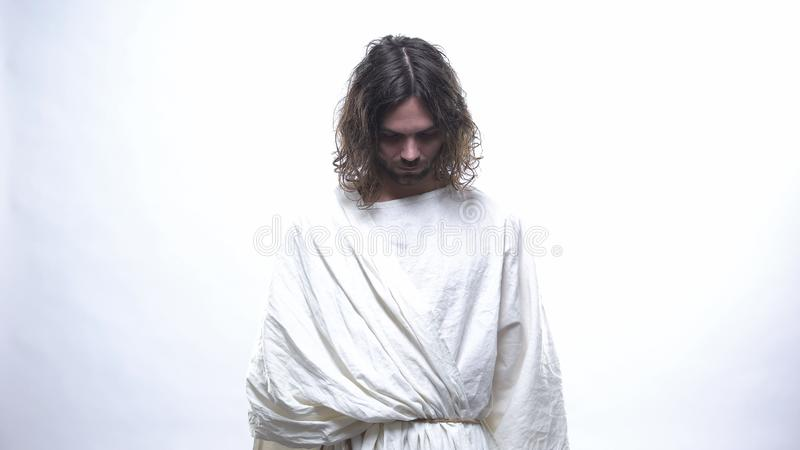Good Jesus looking down in shining gracious light, resurrection of God, belief. Stock photo stock images