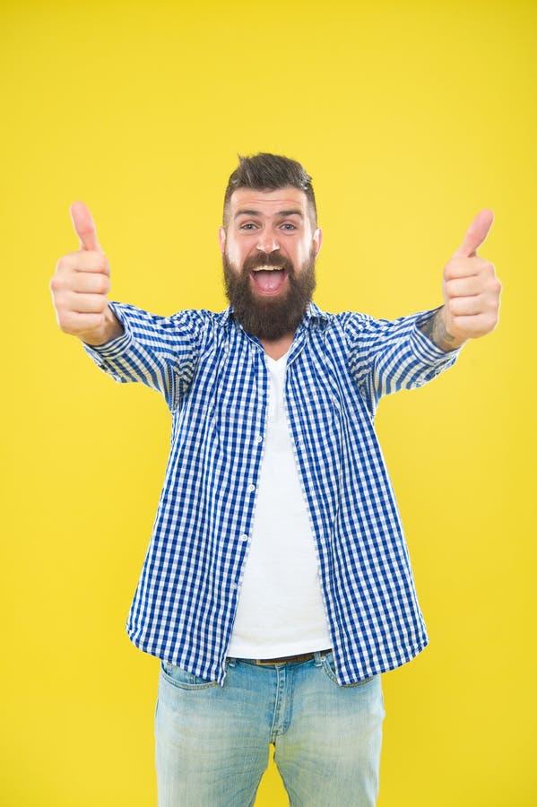 Good job. Beard fashion and barber concept. Man bearded hipster stylish beard yellow background. Barber tips maintain. Beard. Stylish beard and mustache care stock image