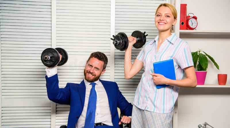 Good job concept. Boss businessman and office manager raise hand with dumbbells. Strong business team. Healthy habits in. Office. Man and women raise heavy royalty free stock photo
