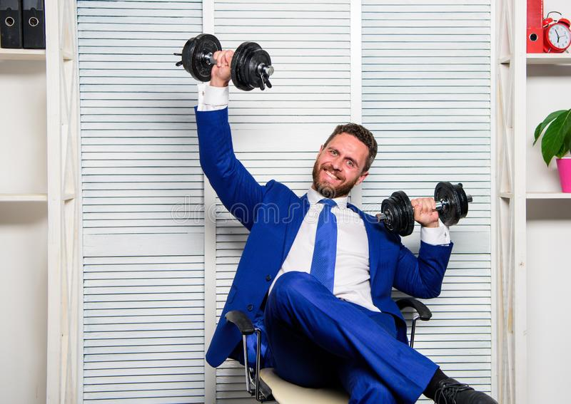 Good job concept. Boss businessman office manager raise hands with dumbbells. Boost business. Boost your managing skill. Man bearded guy raise heavy dumbbells royalty free stock image