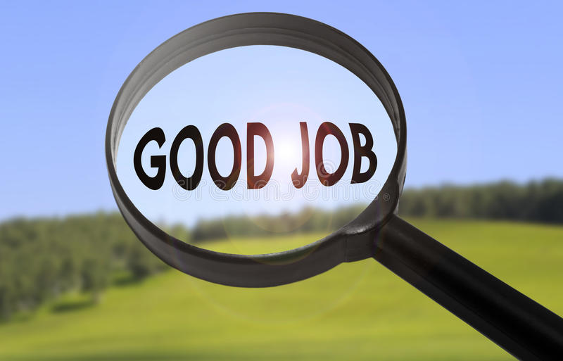 Good job. Magnifying glass with the word good job on blurred nature background. Searching good job concept stock images