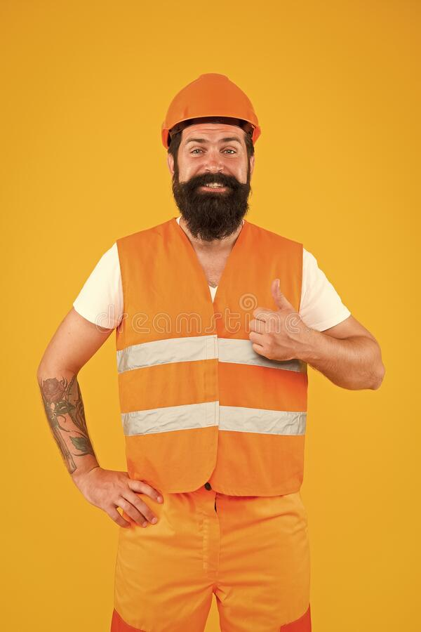 Good job. Safety apparel for construction industry. Bearded brutal hipster safety engineer. Man engineer protective stock photos