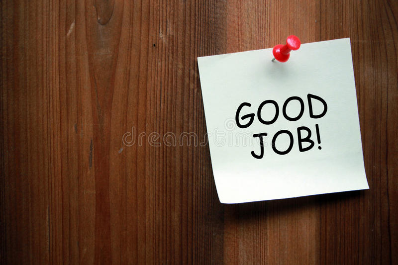 Good Job. Written on note with wooden background royalty free stock image