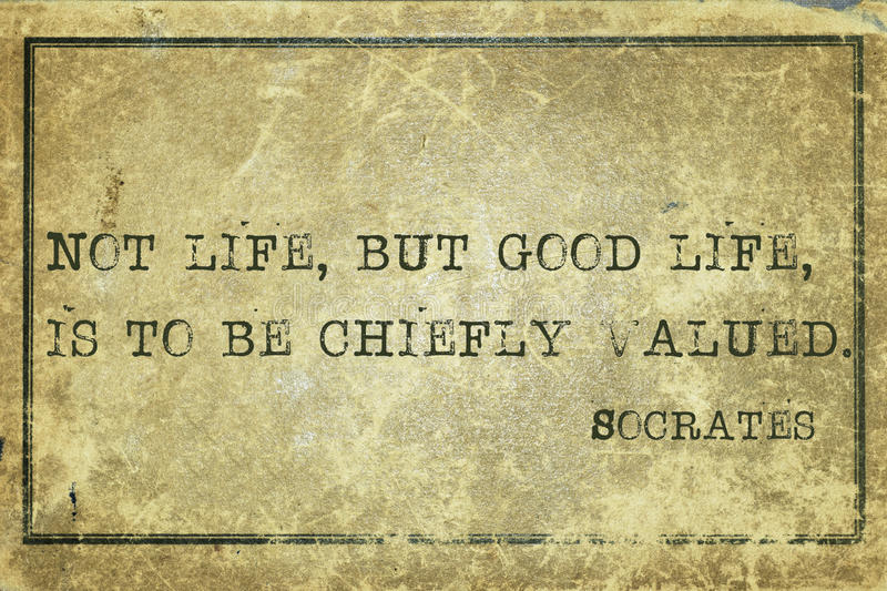 Good life Socrates. Not life, but good life - ancient Greek philosopher Socrates quote printed on grunge vintage cardboard stock photos