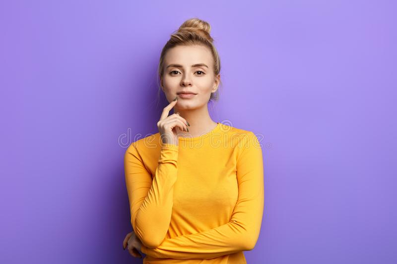Good loking stylish glamour woman with finger on her chin stock images