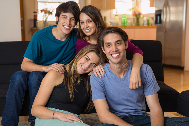 Good looking attractive friends embracing and enjoying each other's company with perfect smiles stock photos