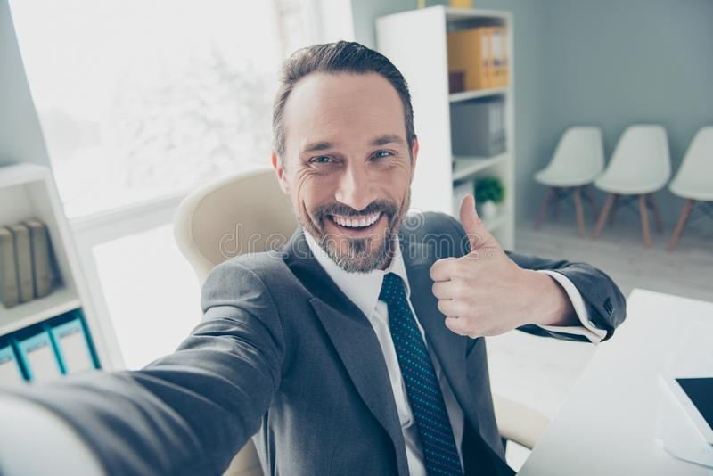 Good-looking brunet hair stubble man in trendy style stylish for. Malwear take selfie demonstration show symbol gesture trust recommend make beaming toothy smile stock photo