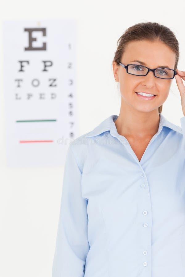 Good looking brunette eye specialist stock photos