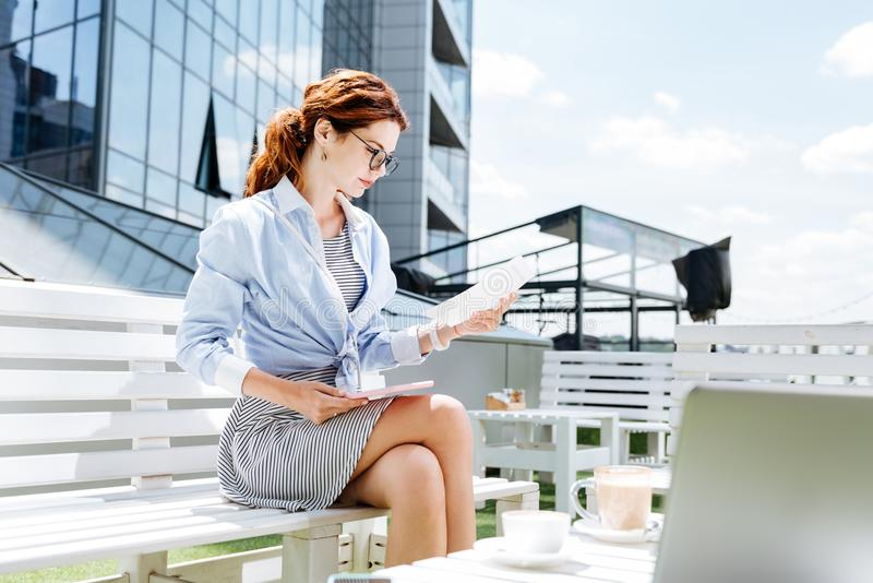 Good-looking fashionable remote worker working on summer terrace stock images