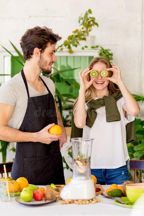 Good looking funny girl has made glasses from kiwi. stock photo