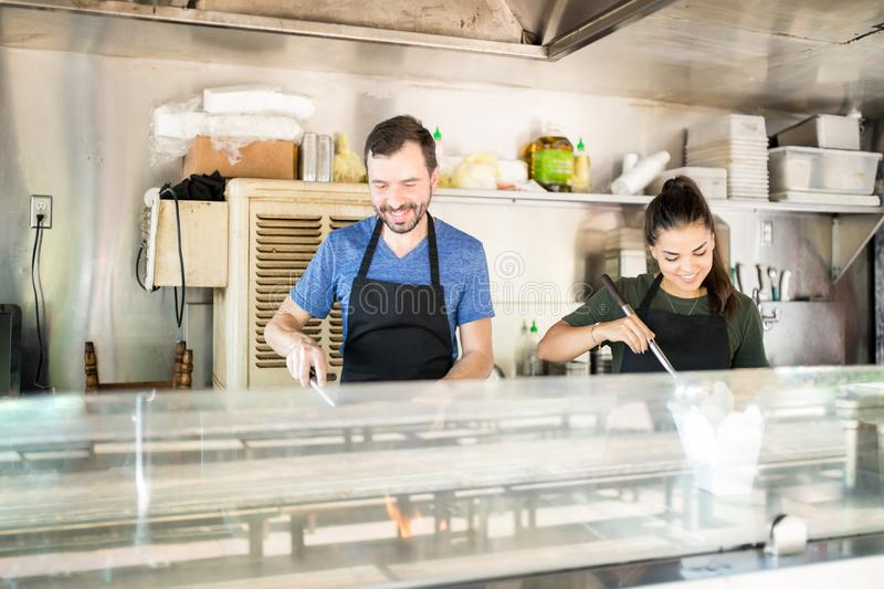 Happy cooks in a food truck stock images