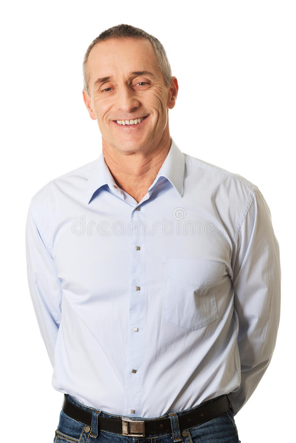 Good looking man holding arms behind him stock photography