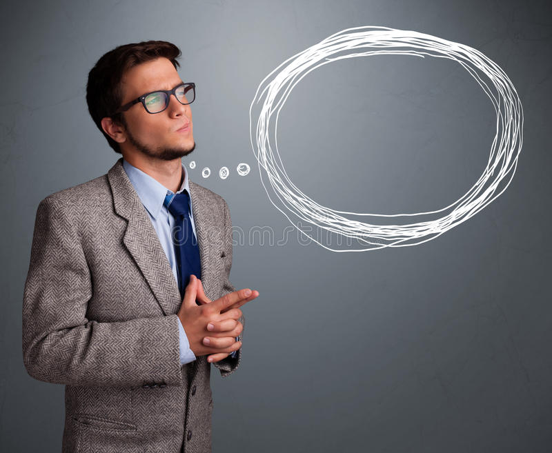 Good-looking man thinking about speech or thought bubble with co royalty free stock image