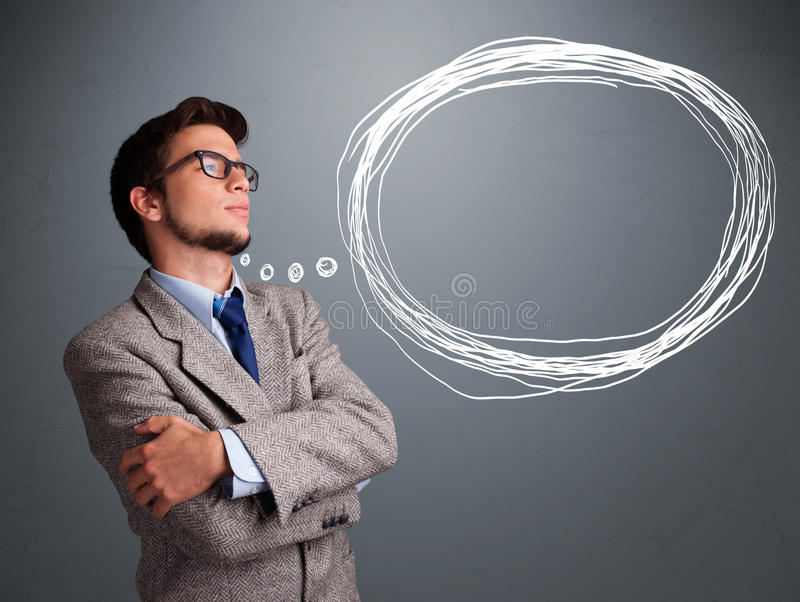 Good-looking man thinking about speech or thought bubble with co royalty free stock images