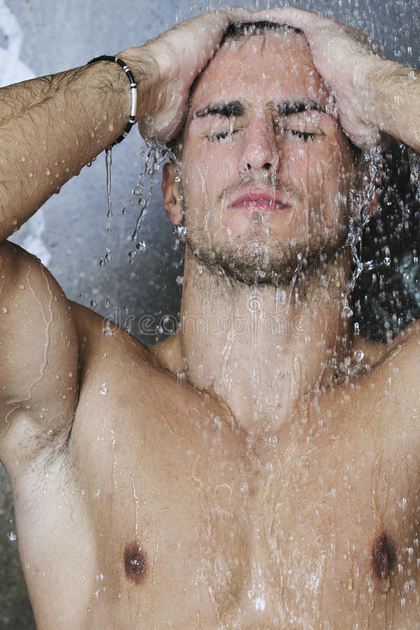 Download Good Looking Man Under Man Shower Stock Image - Image: 14344523