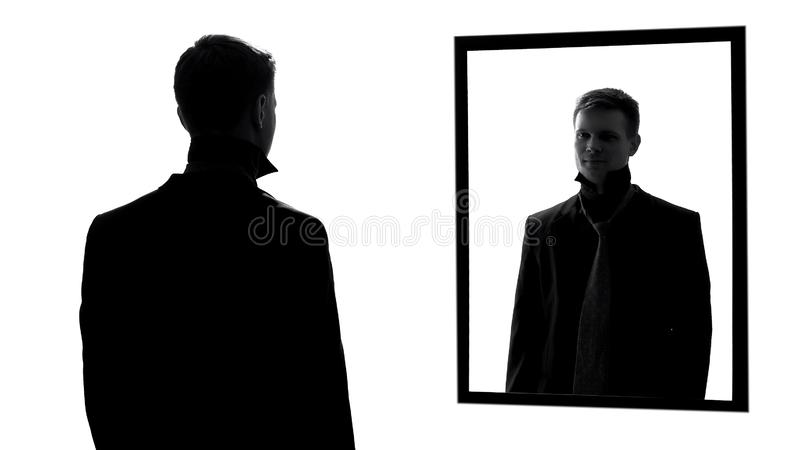 Good looking man wearing suit and tie looking mirror, confident male reflection stock image