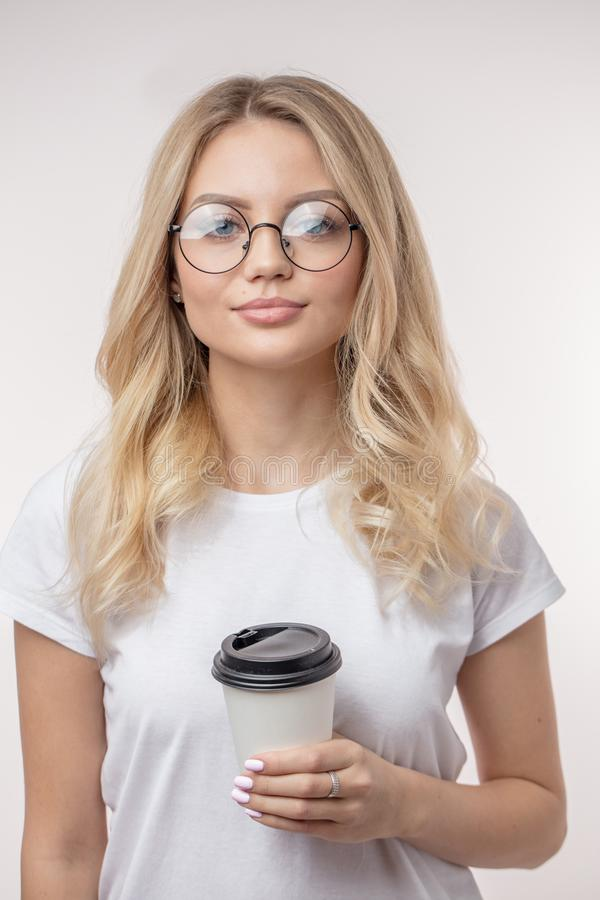 A good looking model with coffee is looking at the camera royalty free stock photography