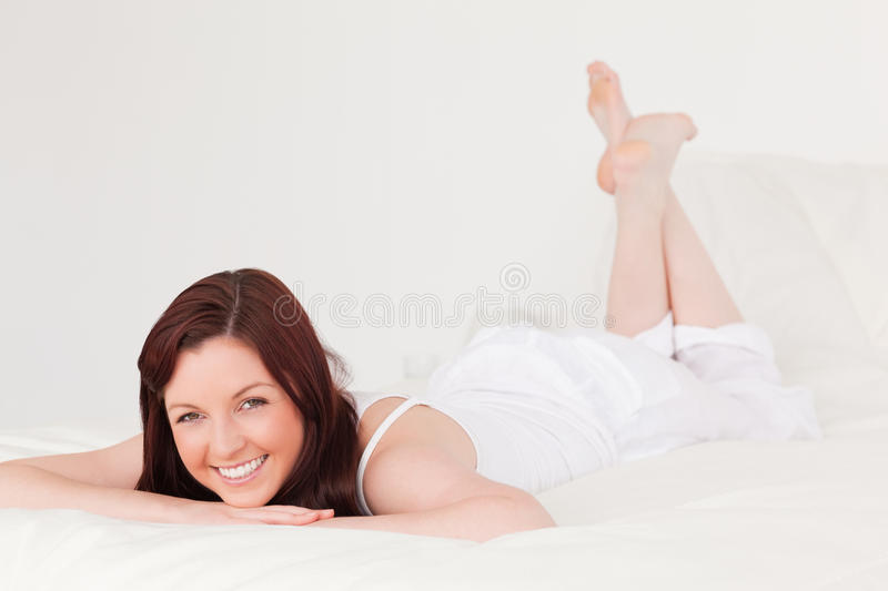Good looking red-haired female having a rest royalty free stock photography