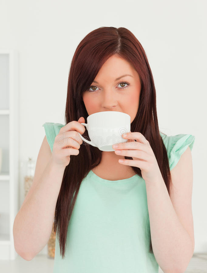 Good Looking Red-haired Woman Having Her Breakfast Stock Photo