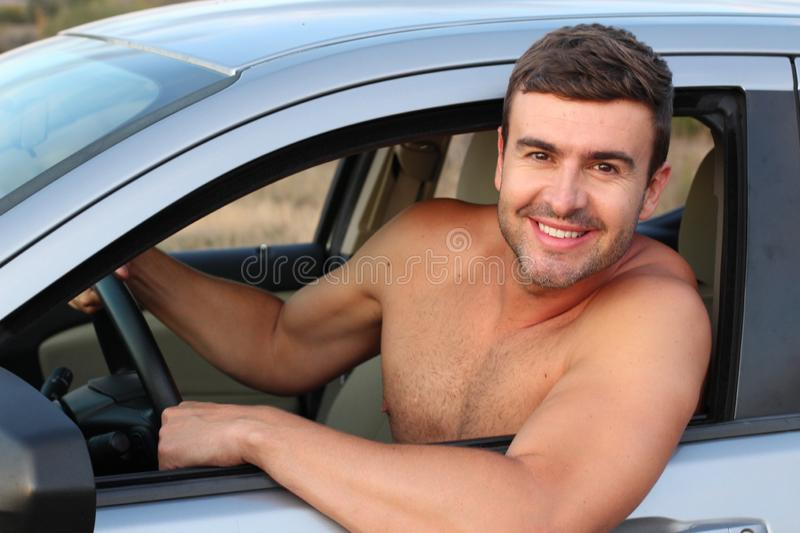 Good looking shirtless male driver stock photos