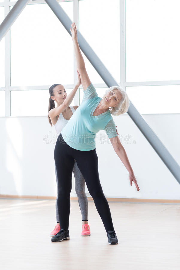 Good looking slim woman bending to the left stock images