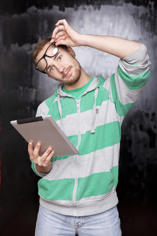 Download Good Looking Smart Nerd Man With Tablet Computer Stock Photo - Image: 22138274