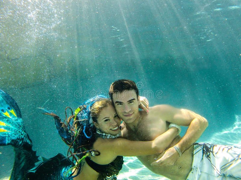 Good Looking Young Man with a Mermaid royalty free stock images