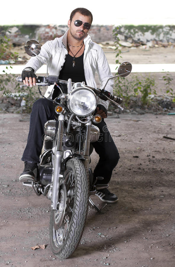 Good looking young man on motorcycle royalty free stock photos