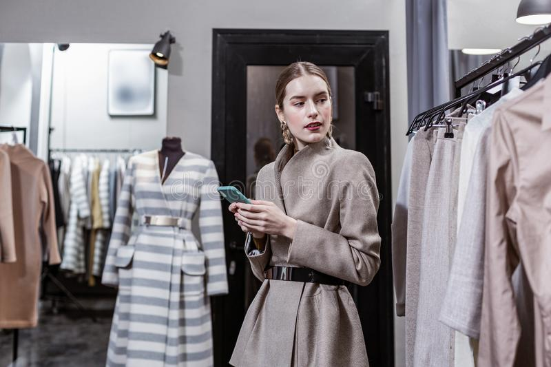 Stylish woman asking her friend for fashion advice stock photo