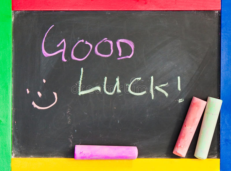 Good luck. Written in chalk on a black board royalty free stock image