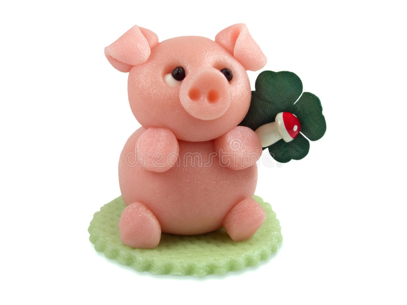 Good luck. Lucky marzipan pig with cloverleaf and mushroom, isolated on white background stock photo