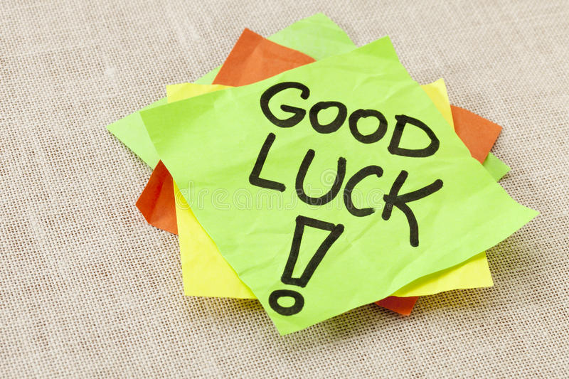 Good luck on sticky note. Good luck - black handwriting on green sticky note against canvas stock photos