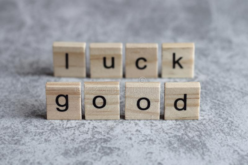 Good luck word written on wood cube. With gray background stock photo