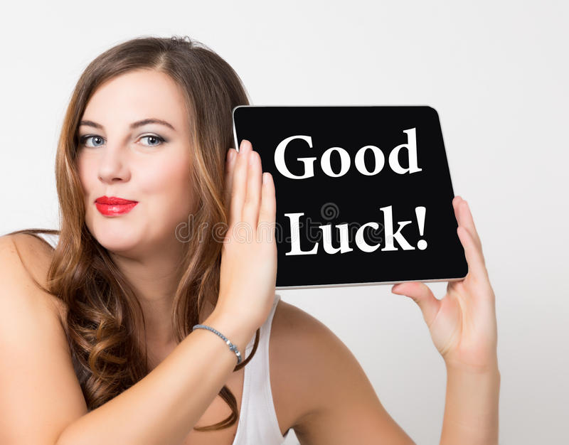 Good luck written on virtual screen. technology, internet and networking concept. beautiful woman with bare shoulders. Holding pc tablet royalty free stock photos