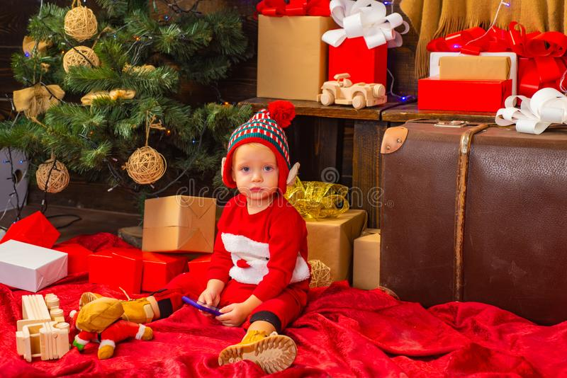 Good Merry Christmas and Happy new year, a greeting and learn from the comfort of home. Happy child girl with a. Christmas gift royalty free stock photo