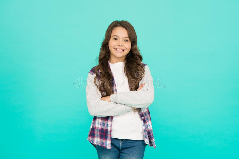 Good mood concept. Positive vibes. Totally satisfied. Shopping day. Feeling cool. Cute girl with long hair. Small girl. Curly hairstyle. International childrens royalty free stock photos