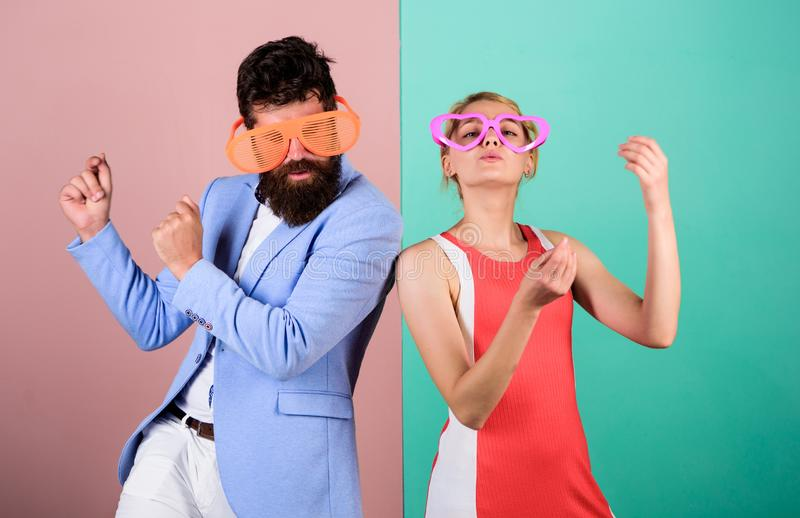 Good mood. Relax and have fun. Corporate culture. Celebrating holiday. Bearded man pretty woman party goggles. Good mood. Relax and have fun. Corporate culture stock photos