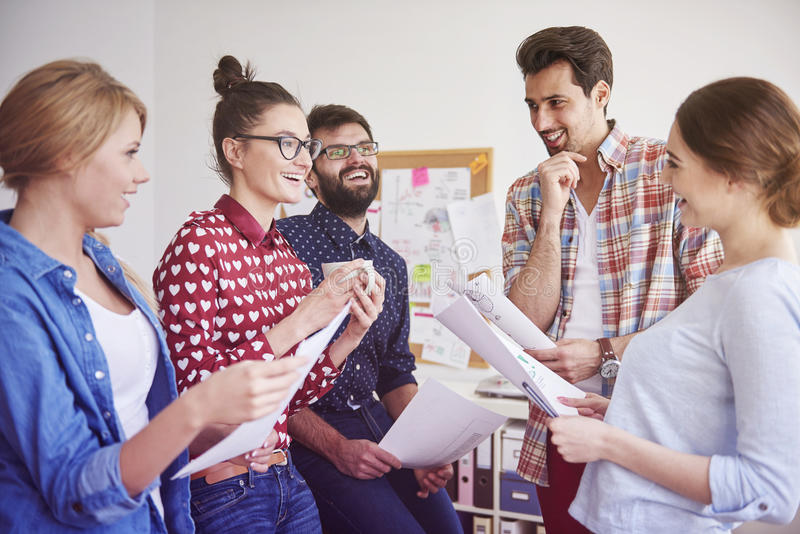 Good mood at work. Good mood never leaves them even at work royalty free stock images