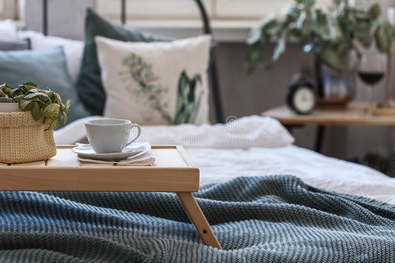 Good mornind. cup of coffee in bed royalty free stock photography