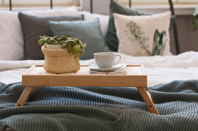 Good mornind. cup of coffee in bed royalty free stock image