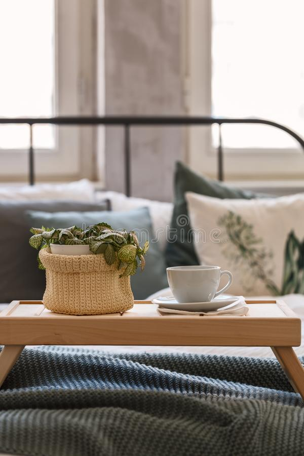Good mornind. cup of coffee in bed stock image