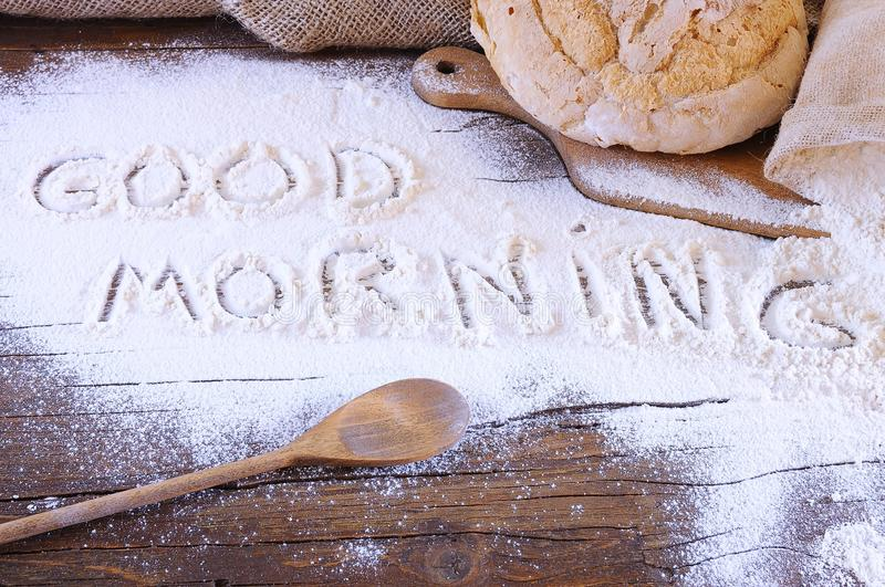 Good morning. Flour on the table of the bakery with the phrase Good Morning stock photos