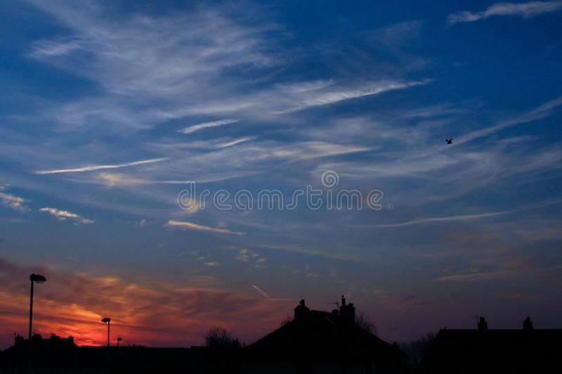 Sunrise. Good Morning, Ainsdale in Merseyside, UK shows a rooftop view of the sun moments before it rose fully, rendering the sky with a tint of beautiful purple royalty free stock photography