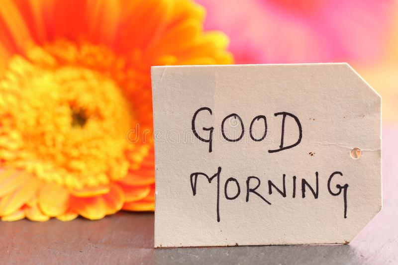 Good morning. Beautiful shot of good morning written on paper tag royalty free stock images
