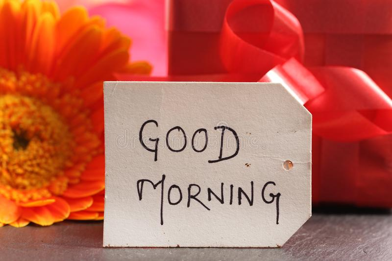 Good morning. Beautiful shot of good morning written on paper tag stock photography